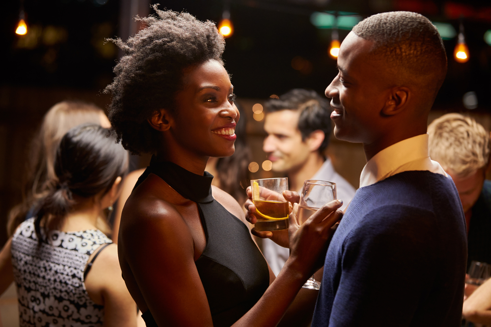 Couples Dancing And Drinking At Evening Party - How To Cheer Up Your Leo Man