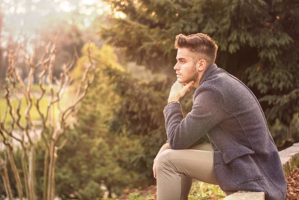 Handsome serious young man outdoors thinking - Leo Man With Virgo Rising