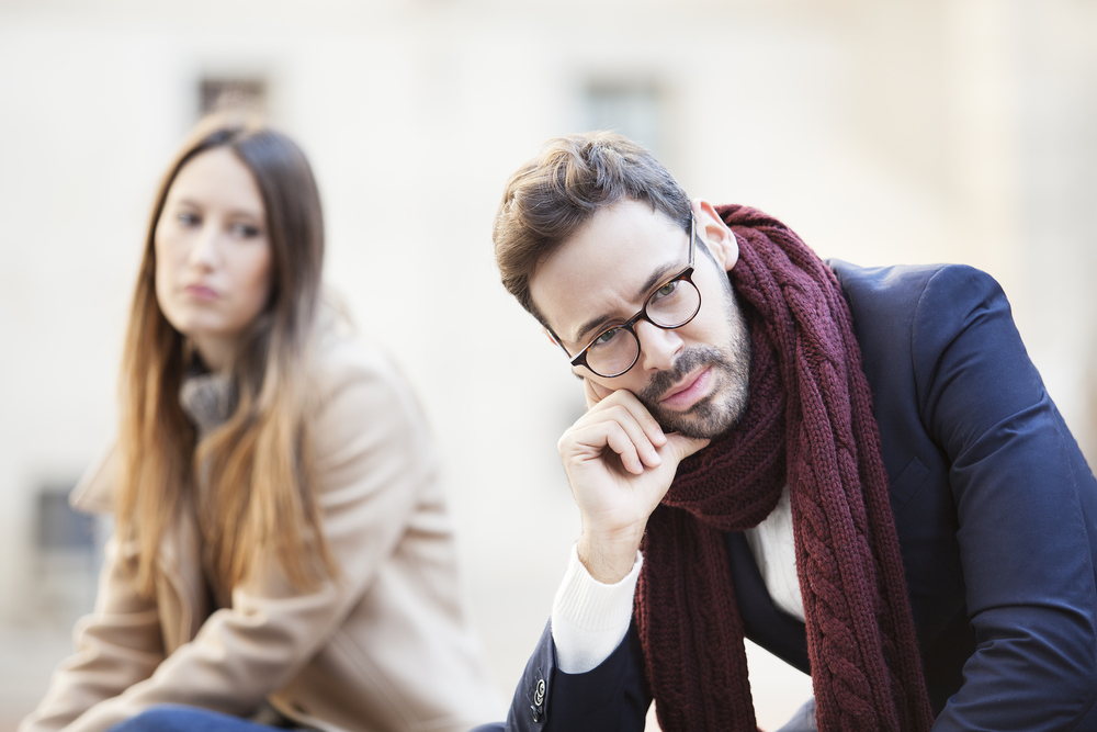 Portrait of young woman and man outdoor on street having relationship problems - Leo Man Acting Distant