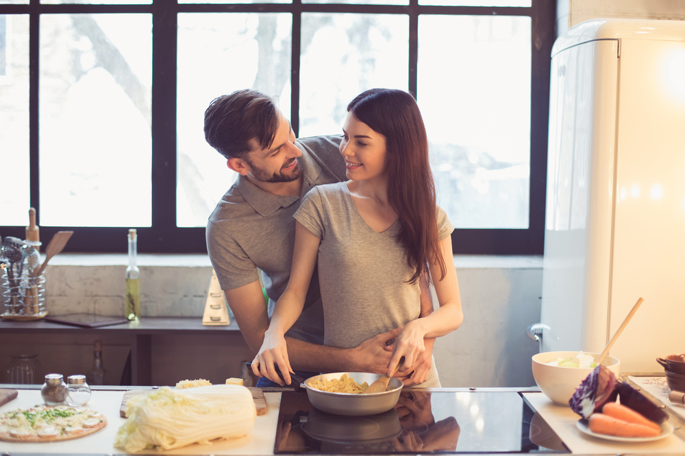 Young beautiful couple in kitchen - How to Please a Leo Man